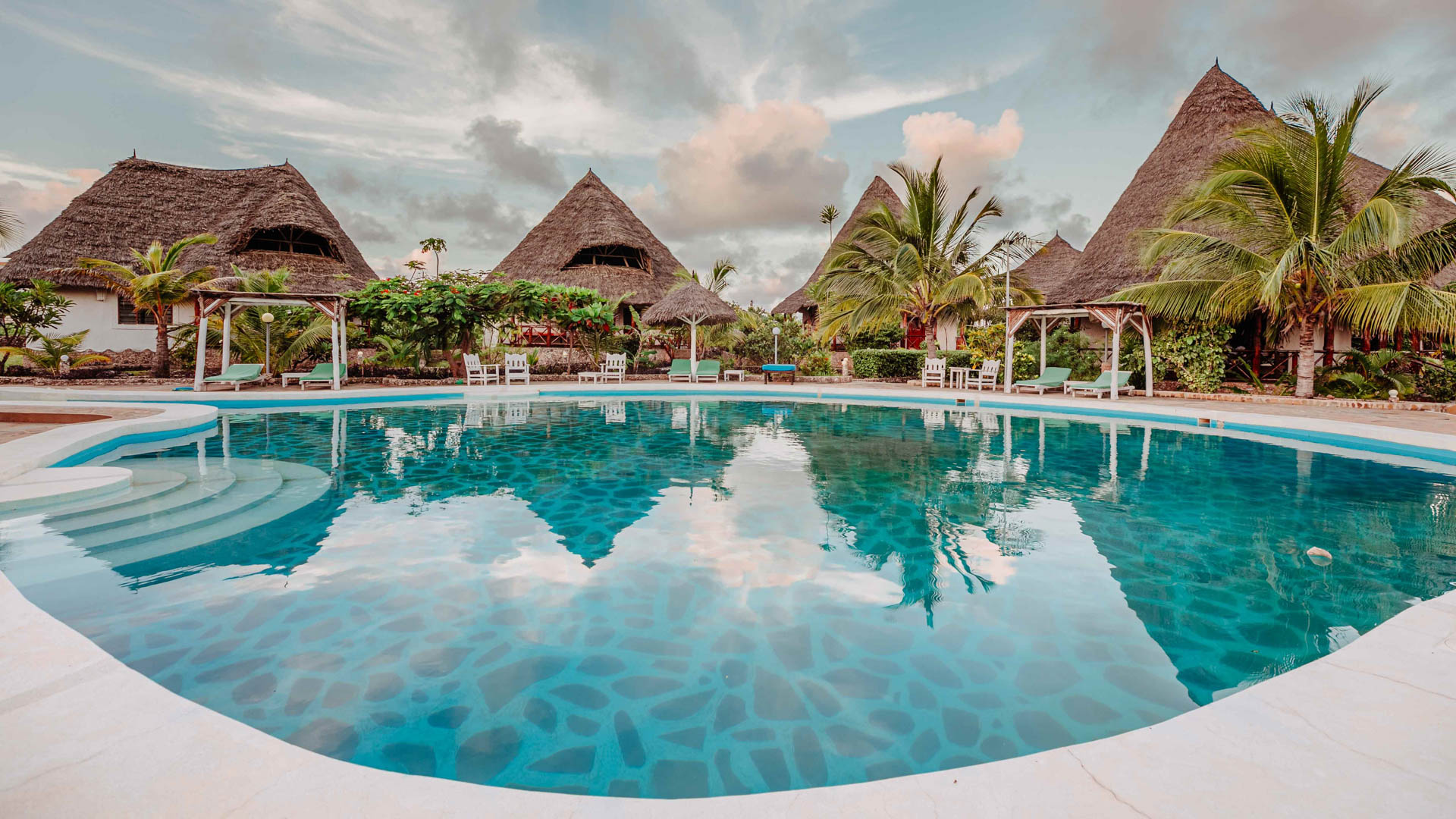 Take a relaxing dip in Malaika Beach Villas' swimming pool, the perfect antidote to a busy day in the city